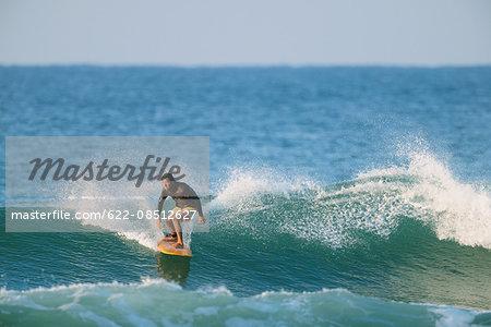Japanese surfer riding wave