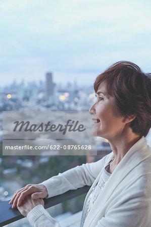 Fashionable Japanese senior woman looking at Tokyo cityscape