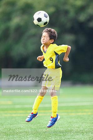 Japanese kid playing soccer