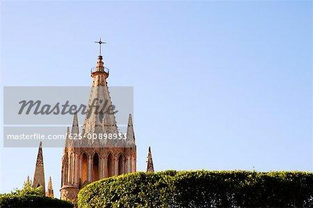 High section view of a cathedral, La Parroquia De San Miguel Arcangel Church, San Miguel De Allende, Guanajuato, Mexico