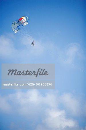 Low angle view of a person parasailing, Miami, Florida, USA