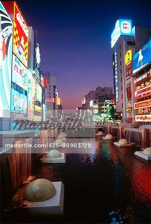 Buildings along a river, Dotombori River, Osaka, Japan