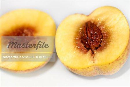 Close-up of a peach cut in half