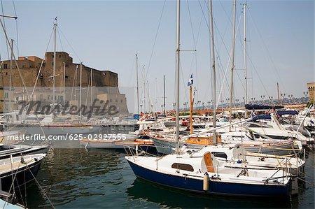 Sailboats docked at a harbor with a castle in the background, Borgo Marinaro, Castel Dell'ovo, Bay of Naples, Naples, Naples Province, Campania, Italy