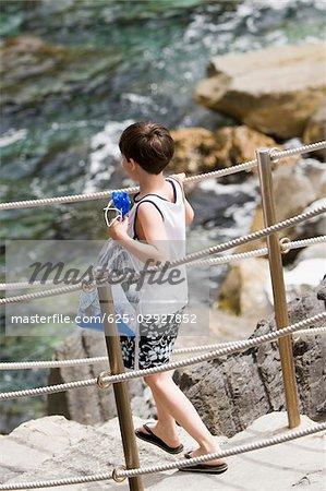 Side profile of a boy walking down steps, Cinque Terre National Park, La Spezia, Liguria, Italy