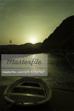 Boat in a river at sunset, Italian Riviera, Cinque Terre National Park, Il Porticciolo, Vernazza, La Spezia, Liguria, Italy