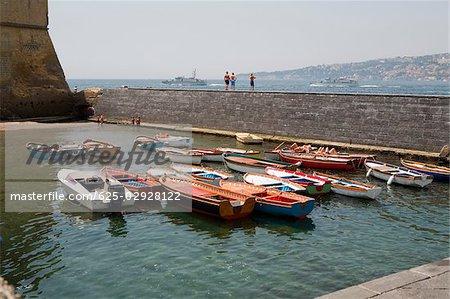 Boats docked at a harbor, Borgo Marinaro, Castel Dell'ovo, Bay of Naples, Naples, Naples Province, Campania, Italy