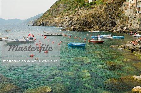 Boats in the sea, Cinque Terre National Park, RioMaggiore, Cinque Terre, La Spezia, Liguria, Italy