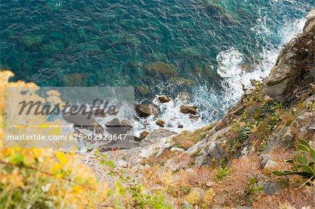 High angle view of rocks in the sea, Italian Riviera, Cinque Terre National Park, Mar Ligure, Cinque Terre, La Spezia, Liguria, Italy