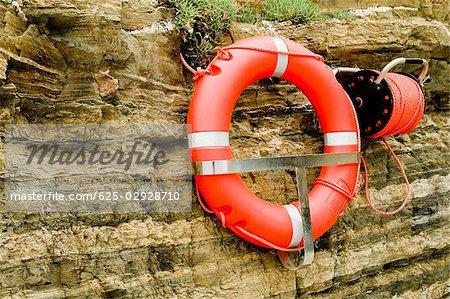 Life belt hanging on cliff, Cinque Terre National Park, RioMaggiore, Cinque Terre, La Spezia, Liguria, Italy