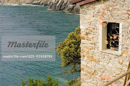 Building at a coast, Italian Riviera, Manarola, La Spezia, Liguria, Italy