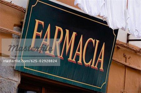 Low angle view of a commercial sign, Italian Riviera, Cinque Terre National Park, RioMaggiore, Cinque Terre, La Spezia, Liguria, Italy