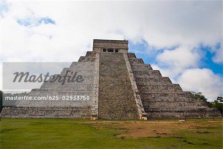 Low angle view of a pyramid on a landscape, Chichen Itza, Yucatan, Mexico