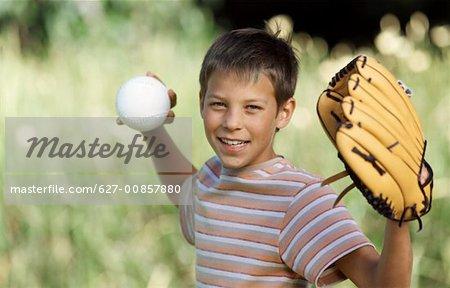 Boy (11-12) throwing baseball