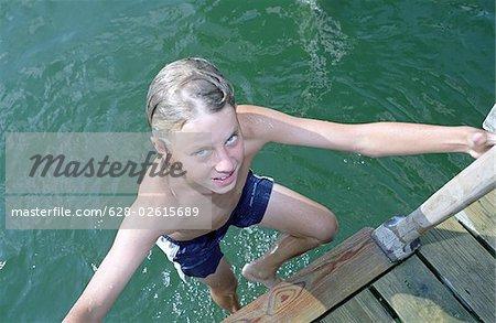 Blonde boy swimming