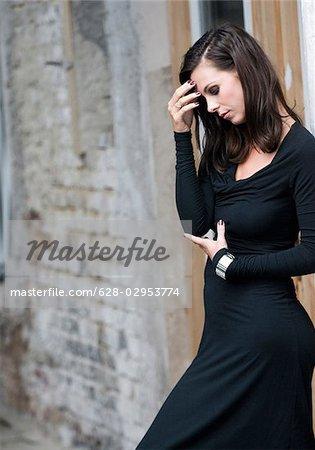 e347790e8 Sad woman wearing black dress - Stock Photo - Masterfile - Premium ...