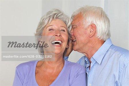 Senior couple whispering