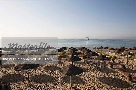 Sunshades on beach, Tunisia