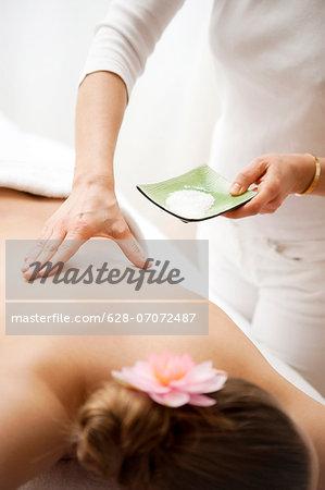 Teenage girl receiving back massage