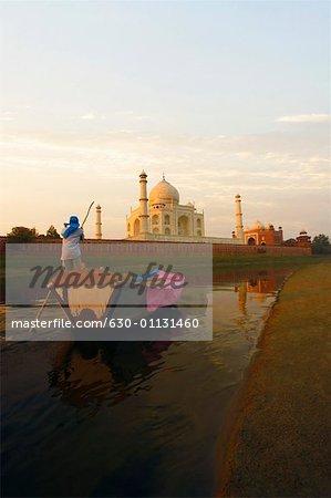 Rear view of a man rowing a boat, Taj Mahal, Agra, Uttar Pradesh, India