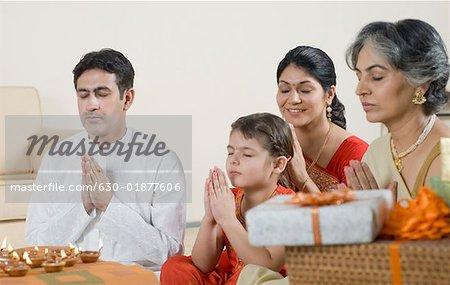 Family performing Lakshmi pujan