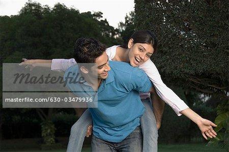 Woman riding piggyback on a man