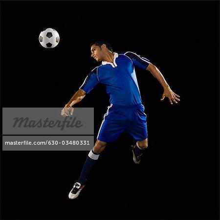 Man heading a soccer ball