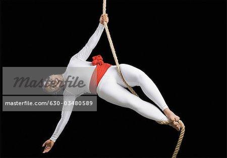 Acrobat performing on a rope