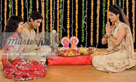 Family doing Diwali pooja
