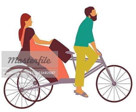 Woman riding a pedicab, India