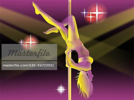 Woman pole dancing in a nightclub