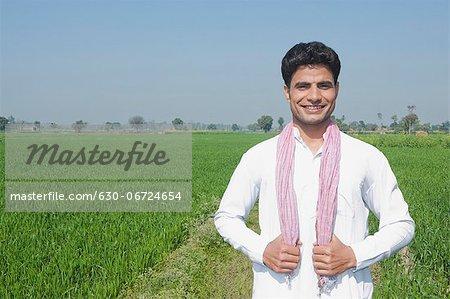 Farmer standing in the field, Sonipat, Haryana, India