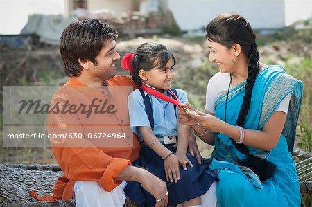 Rural couple enjoying the achievement of their daughter, Sohna, Haryana, India