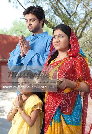 Rural family praying, Sohna, Haryana, India