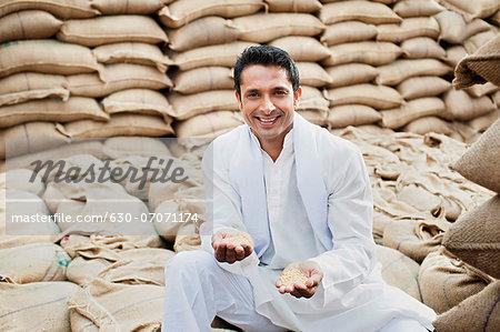Man showing wheat grains, Anaj Mandi, Sohna, Gurgaon, Haryana, India