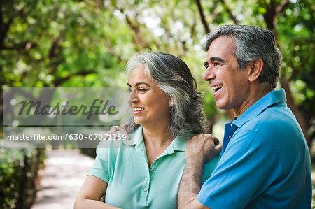 Close-up of a mature couple smiling, Lodi Gardens, New Delhi, India