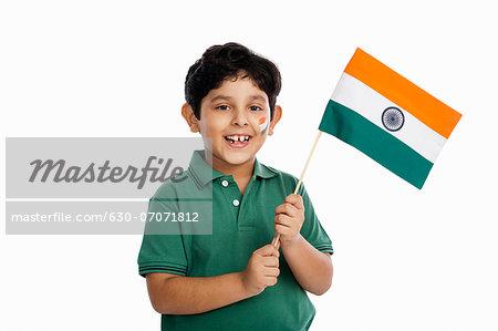 Boy holding an Indian flag