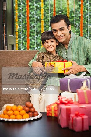 Man and his son celebrating Diwali