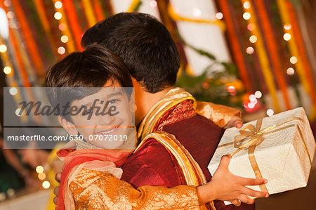 Boy hugging his father on Diwali