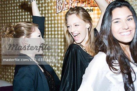 Young women dancing in night club