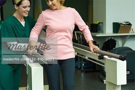 Woman undergoing post-surgery rehabilitation exercises to regain ability to walk