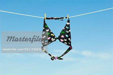 Bikini top hanging on clothes-line