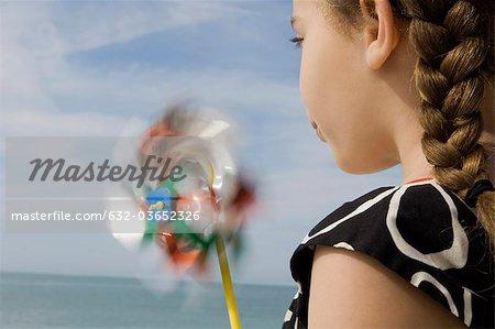 Girl blowing pinwheel
