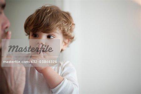 Father hushing toddler boy