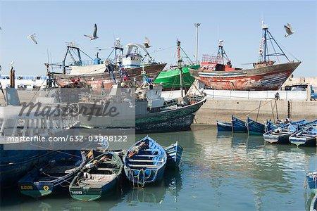 Fishing boats docked in shipyard