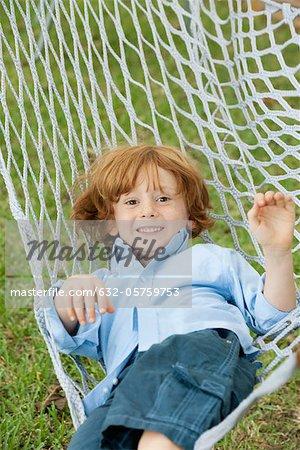 Boy relaxing in hammock, portrait