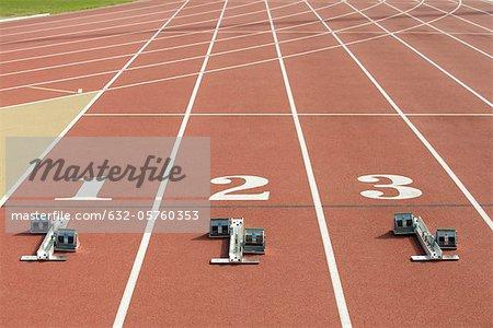 Starting blocks at starting line on running track