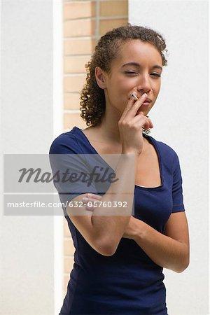 Young woman smoking cigarette