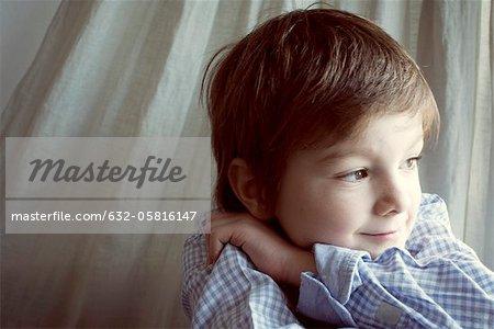 Boy daydreaming, portrait