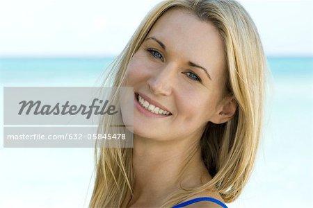 Woman outdoors, smiling, portrait
